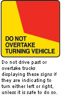 DO NOT OVERTAKE TURNING VEHICLE sign